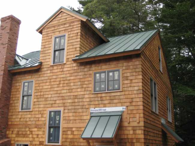 Corrugated Metal Roofing Vs Standing Seam Pros Cons Plus Costs Home Improvement Advice By Remodelgurus Com