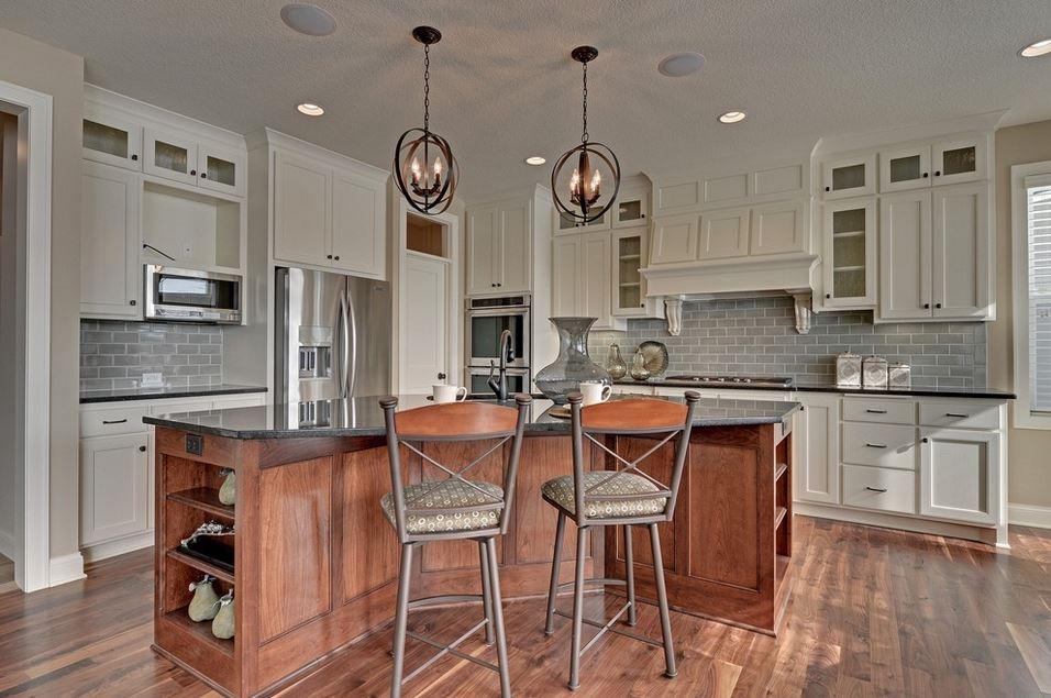 spacious kitchen with two backsplashes