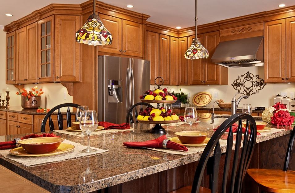 traditional kitchen with maple cabinets and colorful pendant lights