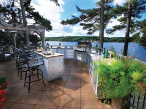 Outdoor kitchen with central seating area